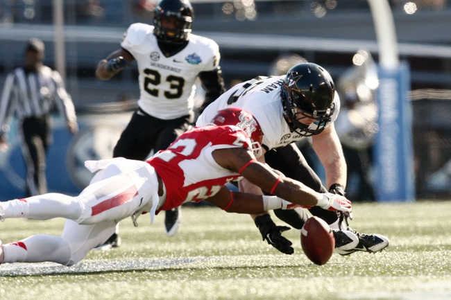 Jan 4, 2014; Birmingham, AL, USA;  Vanderbilt Commodores linebacker Chase Garnham (36) along with Houston Cougars running back Ryan Jackson (22) go for a fumble during the 2014 Compass Bowl at Legion Field. Mandatory Credit: Marvin Gentry-USA TODAY Sports