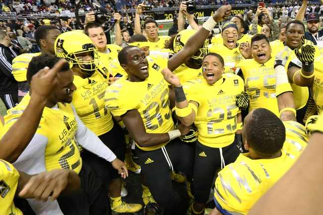 Jan 4, 2014; San Antonio, TX, USA;  Army All-American Bowl West Team celebrates its 28-6 victory over the East during U.S. Army All-American Bowl high school football game at the Alamodome. Mandatory Credit: Soobum Im-USA TODAY Sports