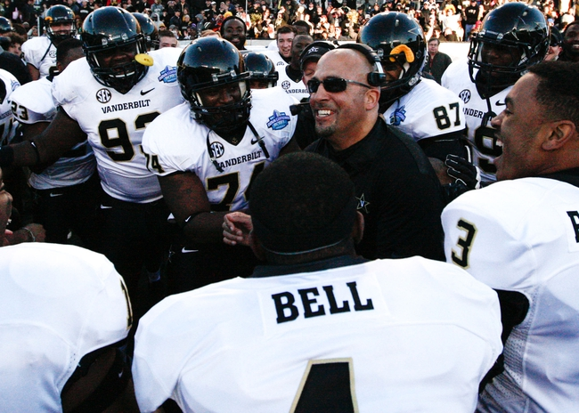 Jan 4, 2014; Birmingham, AL, USA;  Vanderbilt Commodores Coach James Franklin  celebrates with his team at the conclusion of the 2014 Compass Bowl at Legion Field. The Commodores defeated the Cougars 41-24. Mandatory Credit: Marvin Gentry-USA TODAY Sports