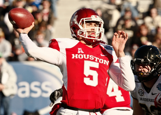 Jan 4, 2014; Birmingham, AL, USA; Houston Cougars quarterback John O'Korn (5) passes against Vanderbilt Commodores during the 2014 Compass Bowl at Legion Field. The Commodores defeated the Cougars 41-24. Mandatory Credit: Marvin Gentry-USA TODAY Sports