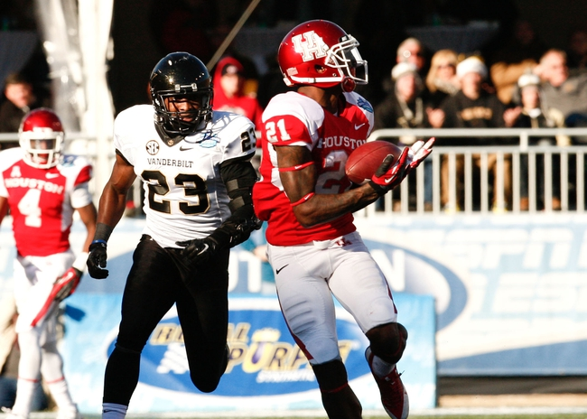 Jan 4, 2014; Birmingham, AL, USA; Houston Cougars wide receiver Markeith Ambles (21) catches a pass against the Vanderbilt Commodores during the 2014 Compass Bowl at Legion Field. The Commodores defeated the Cougars 41-24. Mandatory Credit: Marvin Gentry-USA TODAY Sports