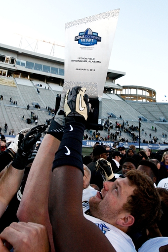 Jan 4, 2014; Birmingham, AL, USA; Vanderbilt Commodores celebrate after winning the 2014 Compass Bowl at Legion Field. The Commodores defeated the Cougars 41-24. Mandatory Credit: Marvin Gentry-USA TODAY Sports