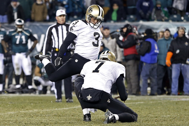 Jan 4, 2014; Philadelphia, PA, USA; New Orleans Saints kicker Shayne Graham (3) kicks the game winning field goal on the final play of the game against the Philadelphia Eagles in the 2013 NFC wild card playoff football game at Lincoln Financial Field. The Saints won 26-24. Mandatory Credit: Geoff Burke-USA TODAY Sports