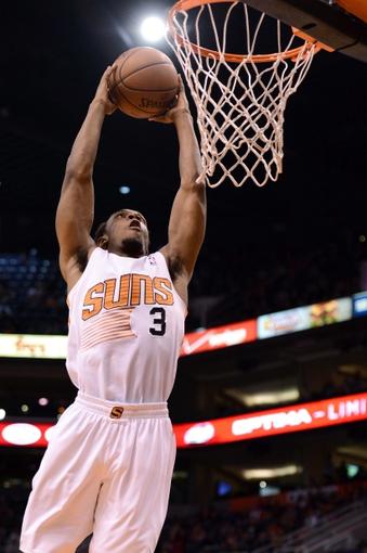 Jan 4, 2014; Phoenix, AZ, USA; Phoenix Suns guard Ish Smith (3) dunks the ball against the Milwaukee Bucks in the second half at US Airways Center. The Suns won 116-100. Mandatory Credit: Jennifer Stewart-USA TODAY Sports