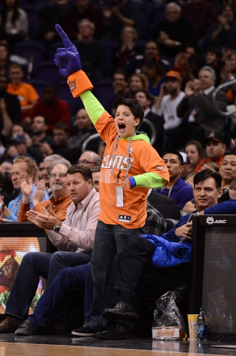 Jan 4, 2014; Phoenix, AZ, USA; A fan cheers from the sidelines in the game the Phoenix Suns and Milwaukee Bucks at US Airways Center. The Suns won 116-100. Mandatory Credit: Jennifer Stewart-USA TODAY Sports