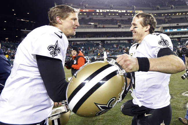 Jan 4, 2014; Philadelphia, PA, USA; New Orleans Saints quarterback Drew Brees (9) celebrates with Saints quarterback Luke McCown (7) after the Saints game against the Philadelphia Eagles in the 2013 NFC wild card playoff football game at Lincoln Financial Field. The Saints won 26-24. Mandatory Credit: Geoff Burke-USA TODAY Sports