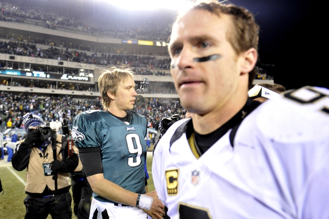 Jan 4, 2014; Philadelphia, PA, USA; New Orleans Saints quarterback Drew Brees (9) and Philadelphia Eagles quarterback Nick Foles (9) leave the field after the 2013 NFC wild card playoff football game at Lincoln Financial Field. The New Orleans Saints won the game 26-24. Mandatory Credit: Joe Camporeale-USA TODAY Sports