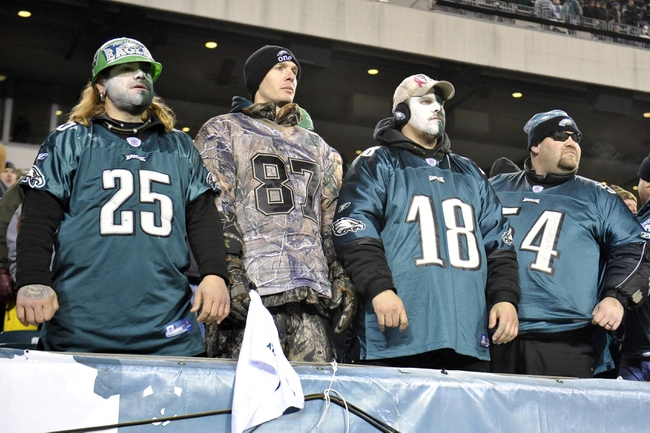 Jan 4, 2014; Philadelphia, PA, USA; Philadelphia Eagles fans look on  after the 2013 NFC wild card playoff football game against the New Orleans Saints at Lincoln Financial Field. The New Orleans Saints won the game 26-24. Mandatory Credit: Joe Camporeale-USA TODAY Sports