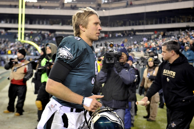 Jan 4, 2014; Philadelphia, PA, USA; Philadelphia Eagles quarterback Nick Foles (9) leaves the field after the 2013 NFC wild card playoff football game against the New Orleans Saints at Lincoln Financial Field. The New Orleans Saints won the game 26-24. Mandatory Credit: Joe Camporeale-USA TODAY Sports