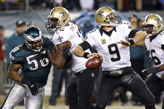 Jan 4, 2014; Philadelphia, PA, USA; New Orleans Saints quarterback Drew Brees (9) throws the ball as Philadelphia Eagles outside linebacker Trent Cole (58) chases in the fourth quarter during the 2013 NFC wild card playoff football game at Lincoln Financial Field. The Saints won 26-24. Mandatory Credit: Geoff Burke-USA TODAY Sports
