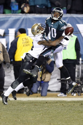 Jan 4, 2014; Philadelphia, PA, USA; Philadelphia Eagles wide receiver DeSean Jackson (10) is interfered with by New Orleans Saints cornerback Corey White (24) while attempting to catch the ball in the fourth quarter during the 2013 NFC wild card playoff football game at Lincoln Financial Field. The Saints won 26-24. Mandatory Credit: Geoff Burke-USA TODAY Sports