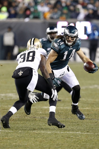Jan 4, 2014; Philadelphia, PA, USA; Philadelphia Eagles wide receiver Riley Cooper (14) runs with the ball as New Orleans Saints cornerback Rod Sweeting (38) defends in the fourth quarter during the 2013 NFC wild card playoff football game at Lincoln Financial Field. The Saints won 26-24. Mandatory Credit: Geoff Burke-USA TODAY Sports