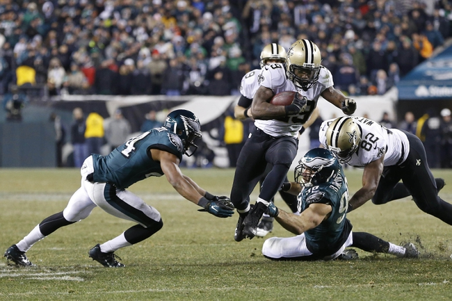 Jan 4, 2014; Philadelphia, PA, USA; New Orleans Saints running back Khiry Robinson (29) runs with the ball past Philadelphia Eagles outside linebacker Connor Barwin (98) and Eagles cornerback Bradley Fletcher (24) in the closing minutes of fourth quarter during the 2013 NFC wild card playoff football game at Lincoln Financial Field. The Saints won 26-24. Mandatory Credit: Geoff Burke-USA TODAY Sports