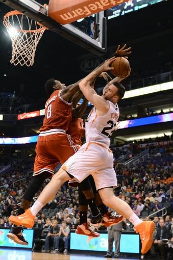 Jan 4, 2014; Phoenix, AZ, USA; Phoenix Suns forward Miles Plumlee (22) in action against the Milwaukee Bucks center Larry Sanders (8) in the second half at US Airways Center. The Suns won 116-100. Mandatory Credit: Jennifer Stewart-USA TODAY Sports