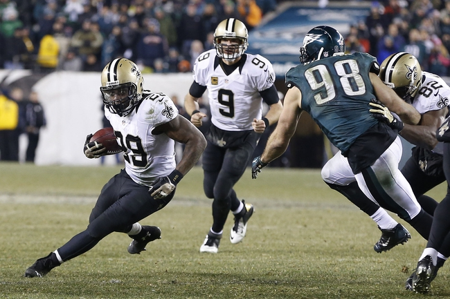 Jan 4, 2014; Philadelphia, PA, USA; New Orleans Saints running back Khiry Robinson (29) carries the ball past Philadelphia Eagles outside linebacker Connor Barwin (98) in he fourth quarter during the 2013 NFC wild card playoff football game at Lincoln Financial Field. Mandatory Credit: Geoff Burke-USA TODAY Sports