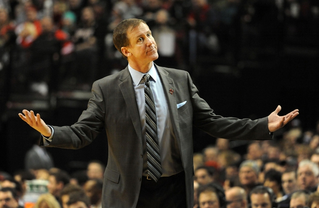 Jan. 04, 2014; Portland, OR, USA; Portland Trail Blazers head coach Terry Stotts reacts to an officials call during the fourth quarter of the game against the Philadelphia 76ers at the Moda Center. The Sixers won the game 101-99. Mandatory Credit: Steve Dykes-USA TODAY Sports
