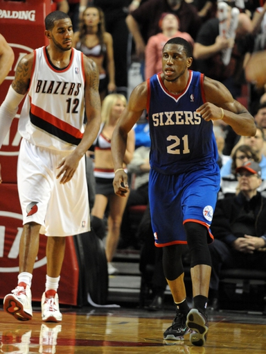 Jan. 04, 2014; Portland, OR, USA; Philadelphia 76ers power forward Thaddeus Young (21) celebrates as Portland Trail Blazers power forward LaMarcus Aldridge (12) looks on after tipping in a shot late during the fourth quarter of the game at the Moda Center. The Sixers won the game 101-99. Mandatory Credit: Steve Dykes-USA TODAY Sports