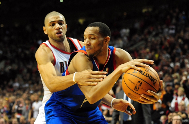 Jan. 04, 2014; Portland, OR, USA; Portland Trail Blazers small forward Nicolas Batum (88) reaches in on Philadelphia 76ers small forward Evan Turner (12) during the fourth quarter of the game at the Moda Center. The Sixers won the game 101-99. Mandatory Credit: Steve Dykes-USA TODAY Sports