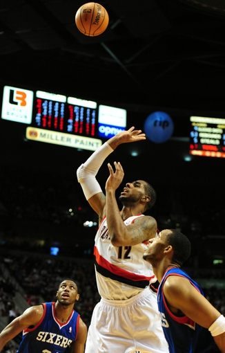 Jan. 04, 2014; Portland, OR, USA; Portland Trail Blazers power forward LaMarcus Aldridge (12) puts up a shot  during the fourth quarter of the game against the Philadelphia 76ers at the Moda Center. The Sixers won the game 101-99. Mandatory Credit: Steve Dykes-USA TODAY Sports