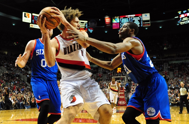 Jan. 04, 2014; Portland, OR, USA; Portland Trail Blazers center Robin Lopez (42) grabs a rebound in front of Philadelphia 76ers power forward Thaddeus Young (21)  during the fourth quarter of the game at the Moda Center. The Sixers won the game 101-99. Mandatory Credit: Steve Dykes-USA TODAY Sports