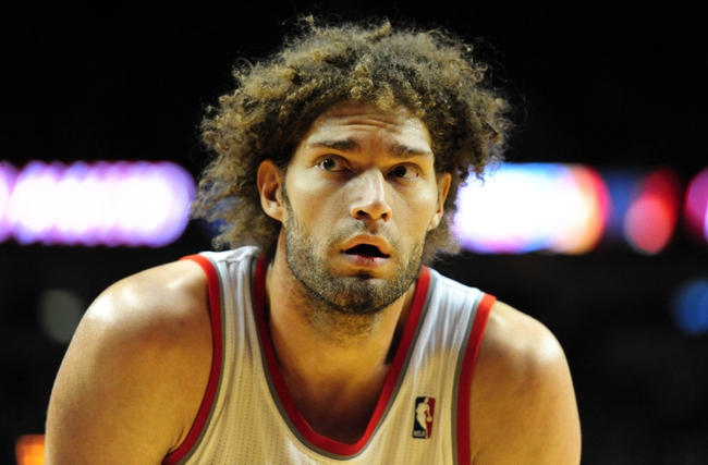Jan. 04, 2014; Portland, OR, USA; Portland Trail Blazers center Robin Lopez (42) waits for play to start during the fourth quarter of the game against the Philadelphia 76ers at the Moda Center. The Sixers won the game 101-99. Mandatory Credit: Steve Dykes-USA TODAY Sports