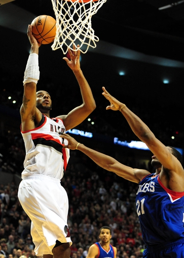 Jan. 04, 2014; Portland, OR, USA; Portland Trail Blazers power forward LaMarcus Aldridge (12) hits a shot over Philadelphia 76ers power forward Thaddeus Young (21) late in the fourth quarter of the game at the Moda Center. The Sixers won the game 101-99. Mandatory Credit: Steve Dykes-USA TODAY Sports