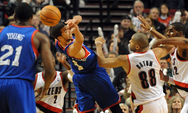 Jan. 04, 2014; Portland, OR, USA; Philadelphia 76ers point guard Michael Carter-Williams (1) tries to pass the ball to  power forward Thaddeus Young (21) as Portland Trail Blazers small forward Nicolas Batum (88) and power forward LaMarcus Aldridge (12) defend during the fourth quarter of the game at the Moda Center. The Sixers won the game 101-99. Mandatory Credit: Steve Dykes-USA TODAY Sports