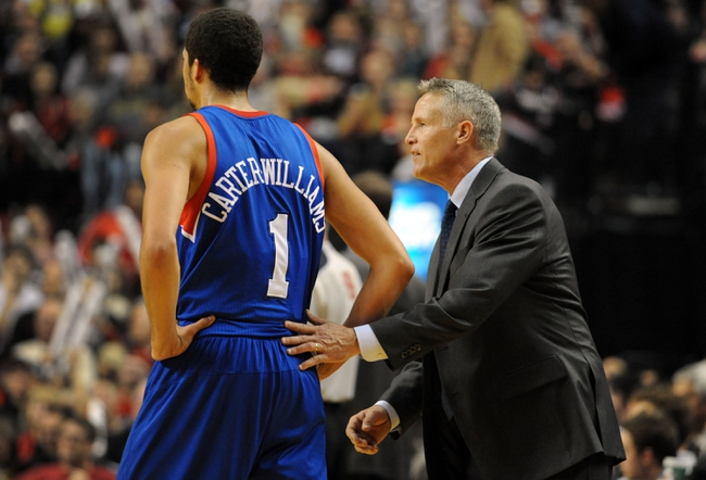 Jan. 04, 2014; Portland, OR, USA; Philadelphia 76ers head coach Brett Brown talks with Philadelphia 76ers point guard Michael Carter-Williams (1) during the third quarter of the game against the Portland Trail Blazers at the Moda Center. The Sixers won the game 101-99. Mandatory Credit: Steve Dykes-USA TODAY Sports