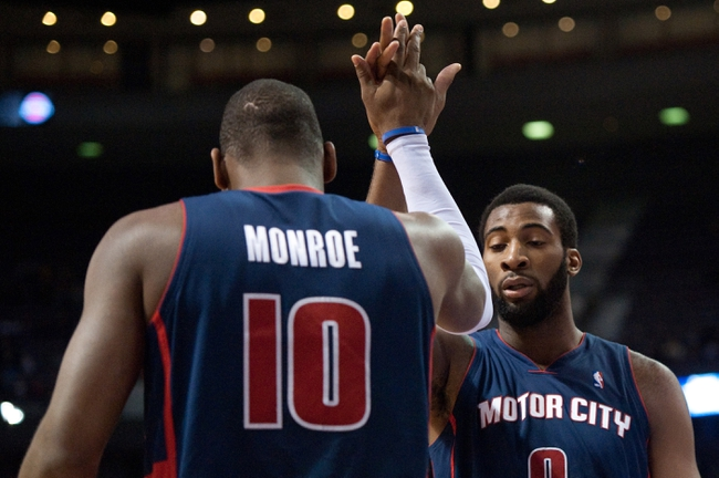 Jan 5, 2014; Auburn Hills, MI, USA; Detroit Pistons center Andre Drummond (0) high fives power forward Greg Monroe (10) during the first quarter against the Memphis Grizzlies at The Palace of Auburn Hills. Mandatory Credit: Tim Fuller-USA TODAY Sports