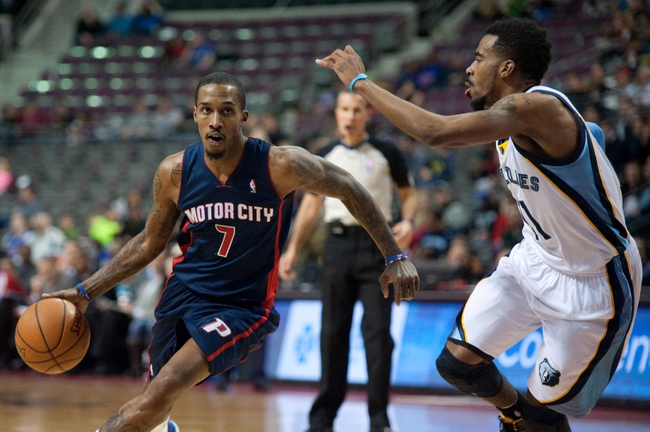 Jan 5, 2014; Auburn Hills, MI, USA; Memphis Grizzlies point guard Mike Conley (11) defends Detroit Pistons point guard Brandon Jennings (7) during the first quarter at The Palace of Auburn Hills. Mandatory Credit: Tim Fuller-USA TODAY Sports