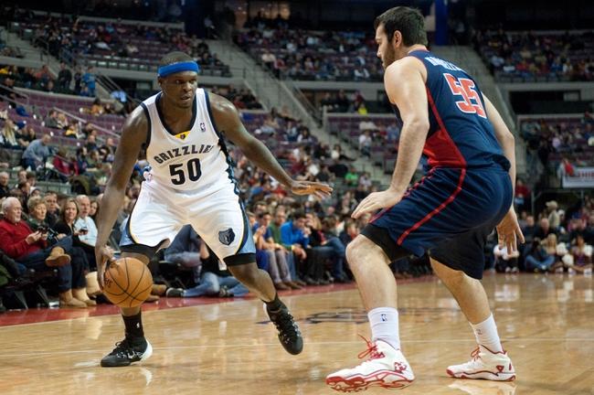 Jan 5, 2014; Auburn Hills, MI, USA; Detroit Pistons power forward Josh Harrellson (55) defends Memphis Grizzlies power forward Zach Randolph (50) during the third quarter at The Palace of Auburn Hills. The Grizzlies won 112-84. Mandatory Credit: Tim Fuller-USA TODAY Sports