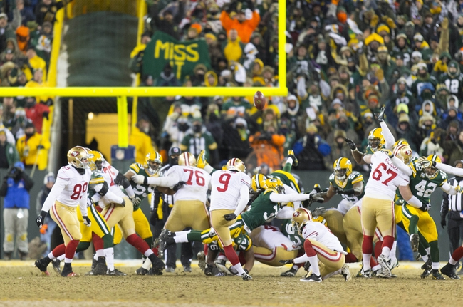 Jan 5, 2014; Green Bay, WI, USA; San Francisco 49ers kicker Phil Dawson (9) kicks the game winning field goal during the fourth quarter against the Green Bay Packers during the 2013 NFC wild card playoff football game at Lambeau Field.  San Francisco won 23-20.  Mandatory Credit: Jeff Hanisch-USA TODAY Sports