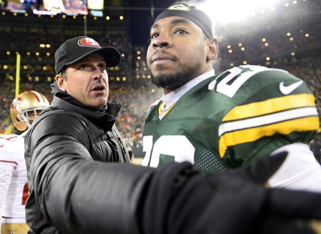 Jan 5, 2014; Green Bay, WI, USA; San Francisco 49ers head coach Jim Harbaugh talks with Green Bay Packers safety Sean Richardson (28) after the 2013 NFC wild card playoff football game at Lambeau Field. San Francisco 49ers defeat the Green Bay Packers 23-20. Mandatory Credit: Mike DiNovo-USA TODAY Sports