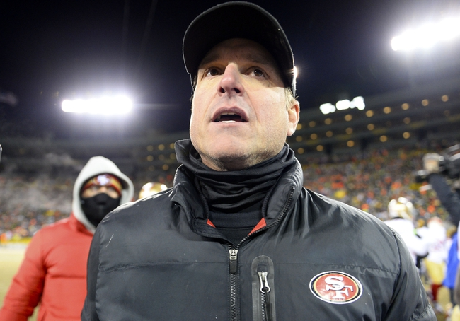 Jan 5, 2014; Green Bay, WI, USA; San Francisco 49ers head coach Jim Harbaugh walks of the field after the 2013 NFC wild card playoff football game at Lambeau Field. San Francisco 49ers defeat the Green Bay Packers 23-20. Mandatory Credit: Mike DiNovo-USA TODAY Sports