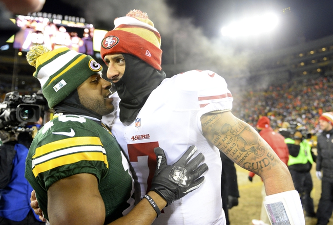 Jan 5, 2014; Green Bay, WI, USA; San Francisco 49ers quarterback Colin Kaepernick (7) talks with Green Bay Packers wide receiver Randall Cobb (18) after the 2013 NFC wild card playoff football game at Lambeau Field. San Francisco 49ers defeat the Green Bay Packers 23-20. Mandatory Credit: Mike DiNovo-USA TODAY Sports
