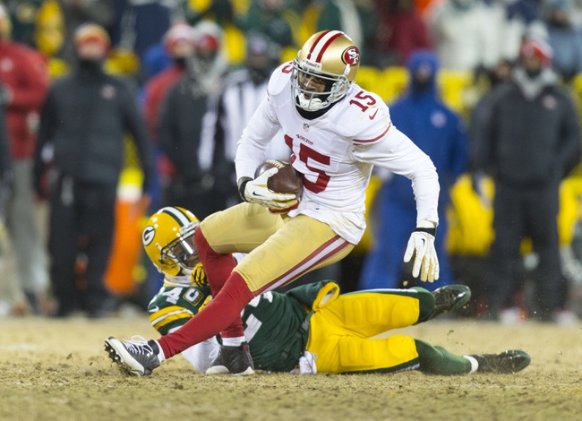 Jan 5, 2014; Green Bay, WI, USA; San Francisco 49ers wide receiver Michael Crabtree (15) is tackled by Green Bay Packers cornerback Jarrett Bush (24) after catching a pass during the fourth quarter of the 2013 NFC wild card playoff football game at Lambeau Field.  San Francisco won 23-20.  Mandatory Credit: Jeff Hanisch-USA TODAY Sports
