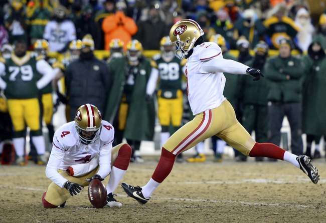 Jan 5, 2014; Green Bay, WI, USA; San Francisco 49ers kicker Phil Dawson (9) kicks the game winning field goal against the Green Bay Packers during the second half of the 2013 NFC wild card playoff football game at Lambeau Field. San Francisco 49ers defeat the Green Bay Packers 23-20. Mandatory Credit: Mike DiNovo-USA TODAY Sports