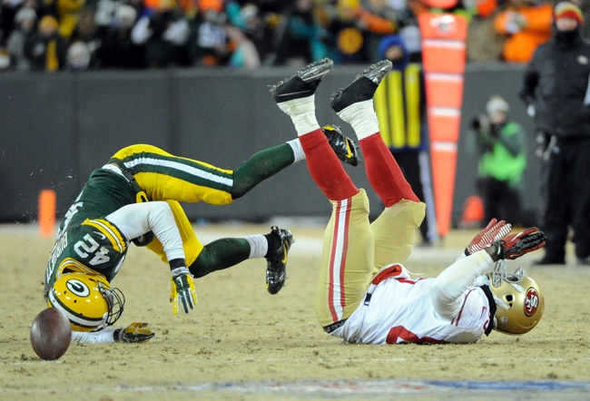 Jan 5, 2014; Green Bay, WI, USA;   Green Bay Packers safety Morgan Burnett (42) knocks a pass away from San Francisco 49ers tight end Vernon Davis (85) in the 4th quarter during the 2013 NFC wild card playoff football game at Lambeau Field. Mandatory Credit: Benny Sieu-USA TODAY Sports