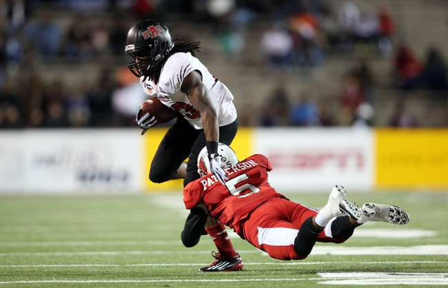 Jan 5, 2014; Mobile, AL, USA; Arkansas State Red Wolves wide receiver J.D. McKissic (23) carries the ball in front of Ball State Cardinals cornerback Eric Patterson (5) in the first half at Ladd-Peebles Stadium. Mandatory Credit: Crystal LoGiudice-USA TODAY Sports