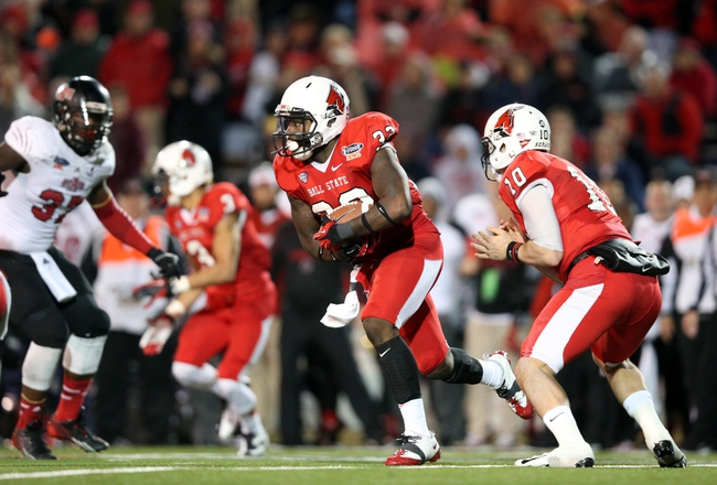 Jan 5, 2014; Mobile, AL, USA; Ball State Cardinals running back Jahwan Edwards (32) carries the ball against the Arkansas State Red Wolves in the first half at Ladd-Peebles Stadium. Mandatory Credit: Crystal LoGiudice-USA TODAY Sports