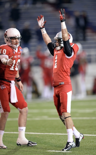 Jan 5, 2014; Mobile, AL, USA;  Ball State Cardinals kicker Scott Secor (1) celebrates his field goal with Ball State Cardinals quarterback Keith Wenning (10) against the Arkansas State Red Wolves during the fourth quarter at Ladd-Peebles Stadium. Mandatory Credit: John David Mercer-USA TODAY Sports