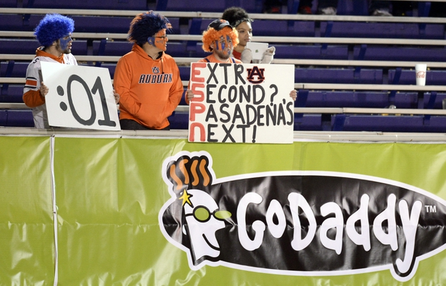 Jan 5, 2014; Mobile, AL, USA;  Auburn Tigers fans make note of the BCS Bowl game tomorrow in Pasadena during the fourth quarter of the Go Daddy Bowl game with the Arkansas State Red Wolves taking on the Ball State Cardinals at Ladd-Peebles Stadium. Mandatory Credit: John David Mercer-USA TODAY Sports