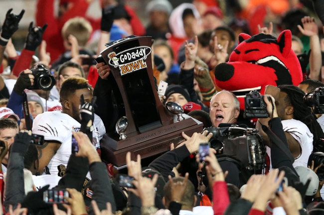 Jan 5, 2014; Mobile, AL, USA; Arkansas State Red Wolves head coach interim head coach John Thompson and his team lift up the trophy after defeating the Ball State Cardinals 23-20 at Ladd-Peebles Stadium. Mandatory Credit: Crystal LoGiudice-USA TODAY Sports