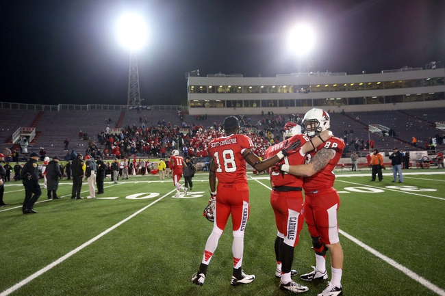 Jan 5, 2014; Mobile, AL, USA; Ball State Cardinals wide receiver Connor Ryan (center) is embraced by teammates tight end Zane Fakes (88) and Ef