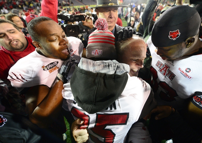 Jan 5, 2014; Mobile, AL, USA;  Arkansas State Red Wolves interim coach John Thompson gets swarmed by his players as they celebrate their 23-20 victory over the Ball State Cardinals at Ladd-Peebles Stadium. Mandatory Credit: John David Mercer-USA TODAY Sports