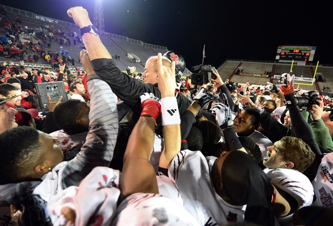 Jan 5, 2014; Mobile, AL, USA;  Arkansas State Red Wolves interim coach John Thompson gets hoisted in the air by his players after their 23-20 victory over the Ball State Cardinals at Ladd-Peebles Stadium. Mandatory Credit: John David Mercer-USA TODAY Sports