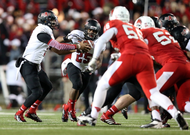 Jan 5, 2014; Mobile, AL, USA; Arkansas State Red Wolves quarterback Fredi Knighten (9) hands the ball off to running back David Oku (25) in the second half at Ladd-Peebles Stadium. Mandatory Credit: Crystal LoGiudice-USA TODAY Sports