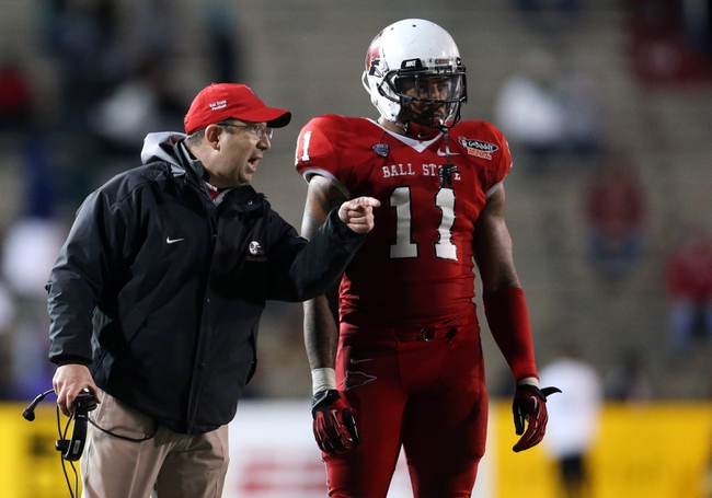 Jan 5, 2014; Mobile, AL, USA; Ball State Cardinals head coach Pete Lembo talks with defensive end Jonathan Newsome (11) at Ladd-Peebles Stadium. Arkansas State Red Wolves defeated the Ball State Cardinals 23-20. Mandatory Credit: Crystal LoGiudice-USA TODAY Sports