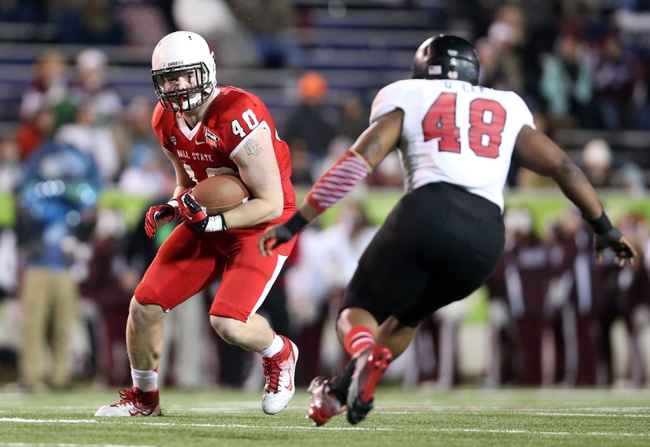 Jan 5, 2014; Mobile, AL, USA; Ball State Cardinals tight end Dylan Curry (40) carries the ball beside Arkansas State Red Wolves linebacker Qushaun Lee (48) in the second half at Ladd-Peebles Stadium. Arkansas State Red Wolves defeated the Ball State Cardinals 23-20. Mandatory Credit: Crystal LoGiudice-USA TODAY Sports