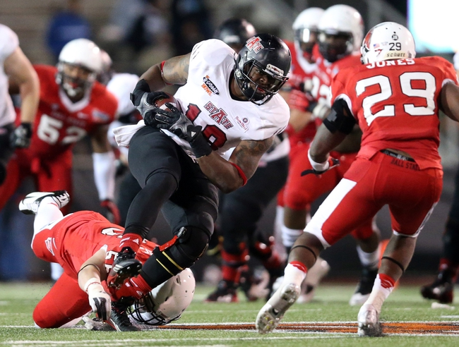Jan 5, 2014; Mobile, AL, USA; Arkansas State Red Wolves tight end Darion Griswold (19) carries the ball against the Ball State Cardinals in the second half at Ladd-Peebles Stadium. Arkansas State Red Wolves defeated the Ball State Cardinals 23-20. Mandatory Credit: Crystal LoGiudice-USA TODAY Sports